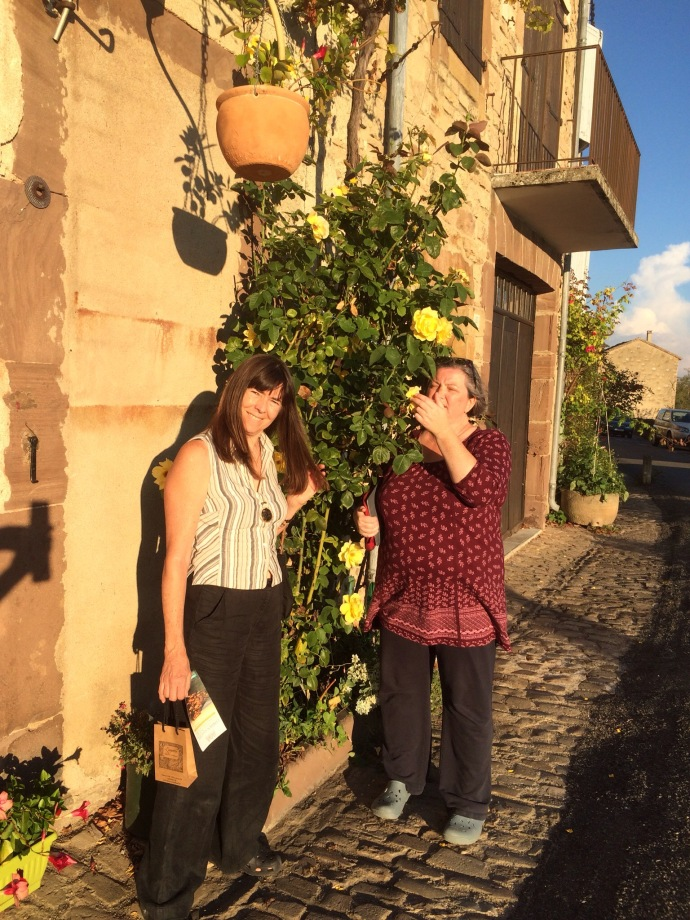 Sheri and Rachel enjoying the aroma of French roses in Cordes Sur Ciel
